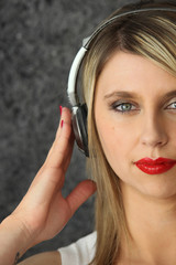 Blond woman wearing headphones