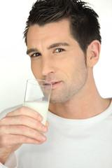 man drinking a milk glass
