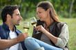 Couple sampling wine whilst visiting vineyard