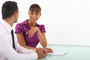 Businessman and woman in conversation