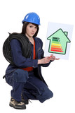 Female electrician explaining energy rating system