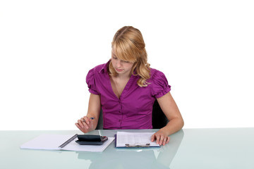 Woman using a calculator at work