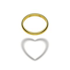 金の指輪とハートの影