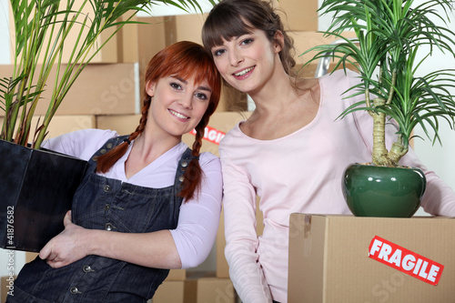 Young women moving into their new apartment