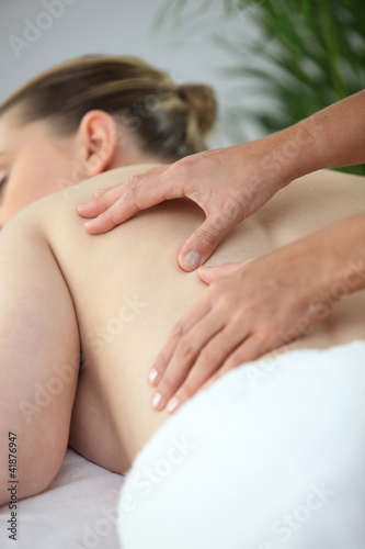 Woman mid back massage