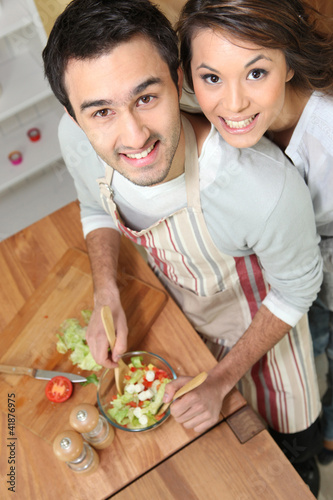 Top-view of couple making salad