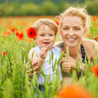 Mother and son in poppy field