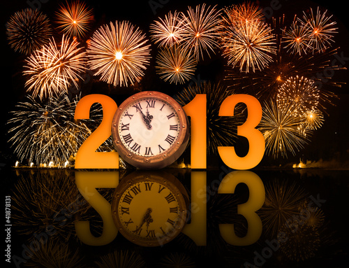 2013 year with fireworks and clock displaying 5 minutes before m