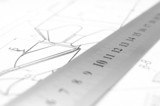The drawing and ruler.