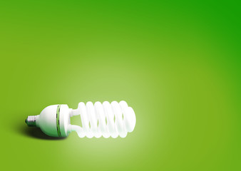 Compact fluorescent light bulb green background