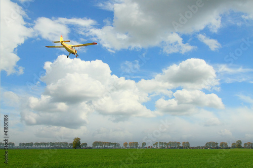 Yellow Aircraft against Overcast Sky