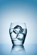 Ice in glass of vodka.