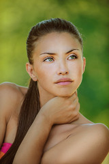 woman with bare shoulders looked thoughtfully at thoron