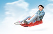 Young girl fly on a sled in the snow, concept winter driving