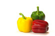 Green, red and yellow paprika (pepper) on a white background