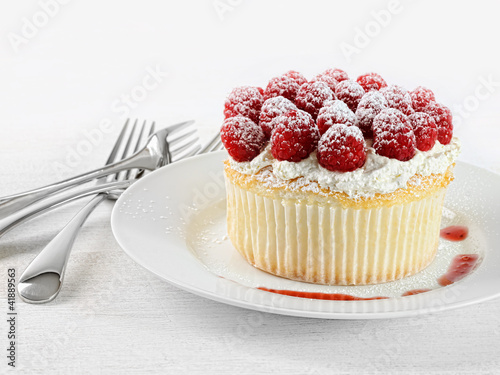 Cupcake with raspberries and cream