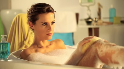 beautiful woman in bathtub with foam