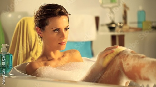 beautiful woman in bathtub with foam