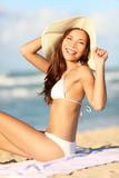 Happy beach vacation woman