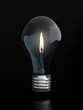 Light bulb with candle flame