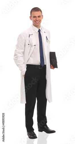 Goodlooking young doctor looking at camera
