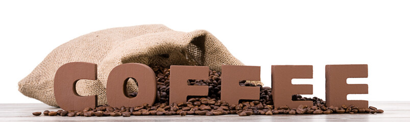 Coffee letters over sack full of coffee beans