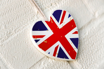 Rustic Union Jack heart decoration on white painted wall
