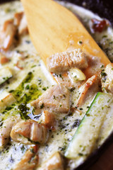 Chicken meat and courgette in cream sauce