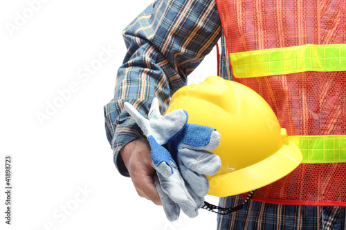 man holding yellow helmet over white