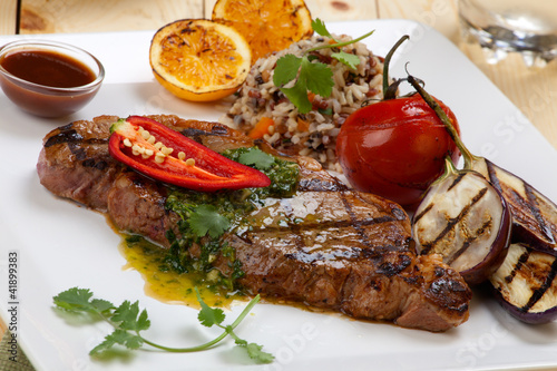 Piece of Medium Rare Steak with Spicy Herb Sauce