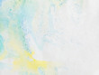 paper with blue green and yellow paint abstract