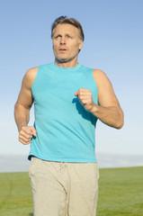man jogging in blue shirt