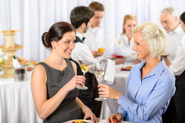 Business meeting two women celebrate champagne