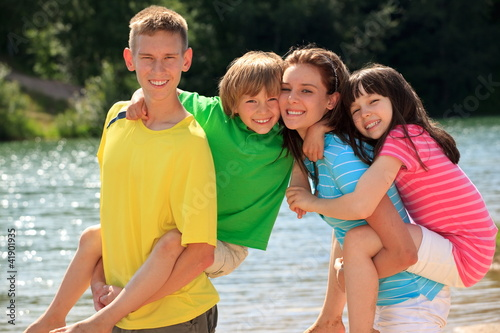 Happy children by lake