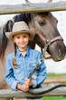 Horse and lovely girl on a ranch - best friends