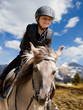 Horse riding - portrait of lovely equestrian on a horse - 41902345