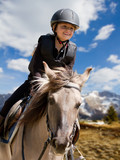 Horse riding - portrait of lovely equestrian on a horse poster