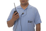 Security guard hand holding cb walkie-talkie radio poster