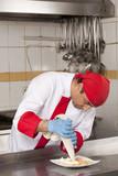 chef garnishing canapes