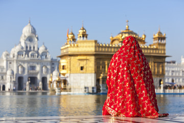 Woman in a sari sat opposite, Golden Temple, Amritsar, India