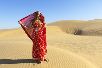 Woman wears red saree, Thar Desert, Rajasthan, India.