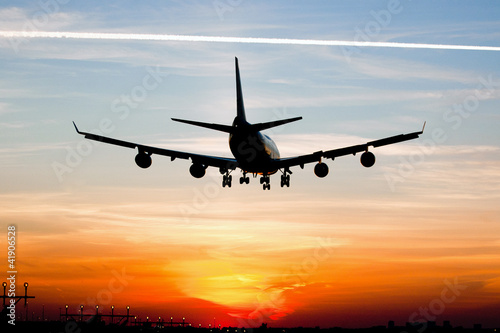 Plane landing by sunrise - 41906528
