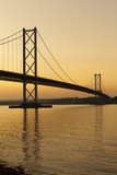 The Forth road bridge at sunset near Edinburgh, Scotland.