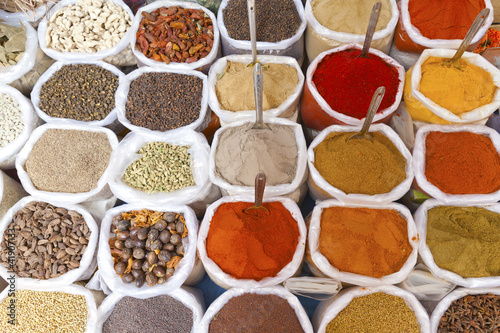 Piles of colorful spices, Anjuna market, Goa, India.