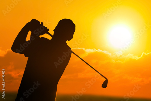 Photo of a Golfer in  Sunset
