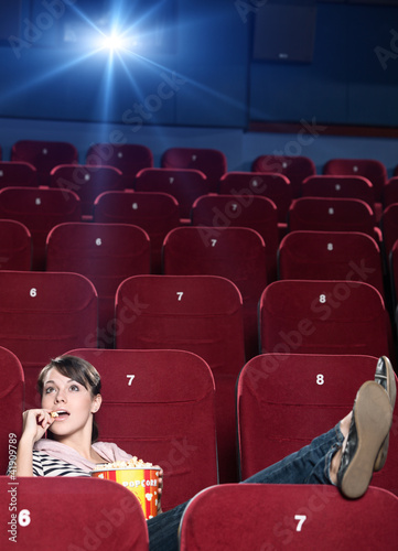 A girl with popcorn at the cinema