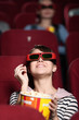 Young woman at the 3D cinema