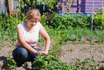 woman doing work in her garden