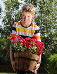 12 years old boy with potted flower