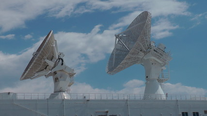 Telecommunication antennas on a warship time lapse
